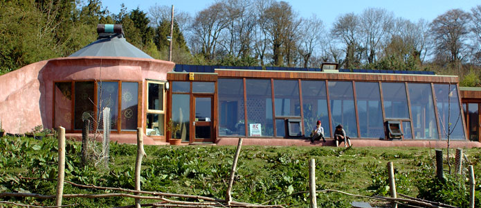 https://brightonpermaculture.org.uk/wp-content/uploads/courses/earthship/slideshow/earthship01.jpg