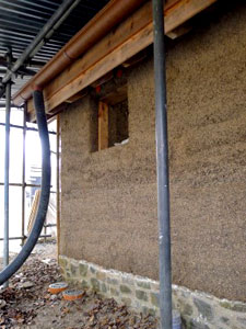 Freshly cast hempcrete wall showing plinth